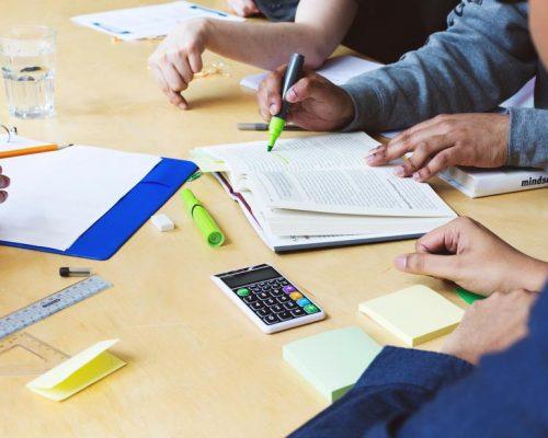 student-team-meeting-at-table.jpg